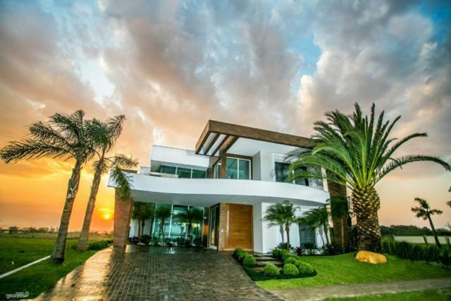 Casa em Condomínio 6 dormitórios em Capão da Canoa | Ref.: 4560